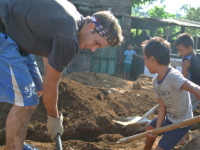 SJC student digging a trench
