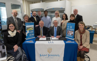 Saint Joseph's College and UNE personnel gather at signing of Pre-Pharmacy Agreement