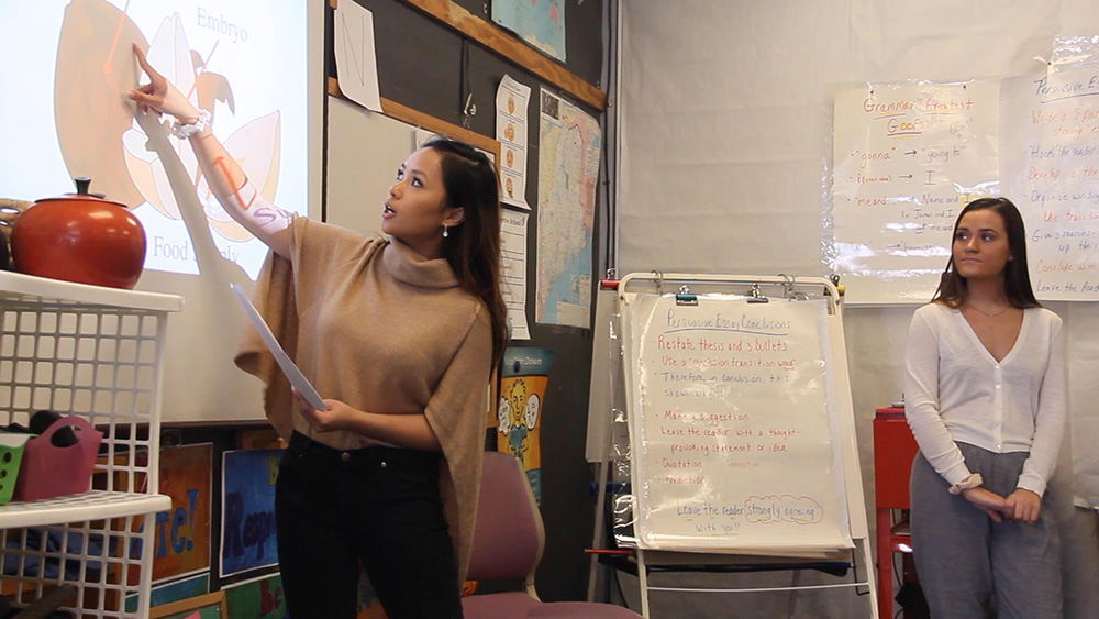 Education student teaches in the classroom