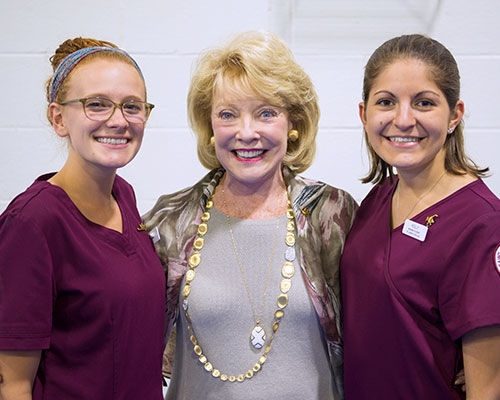 Jeanne Arnold with two nursing students