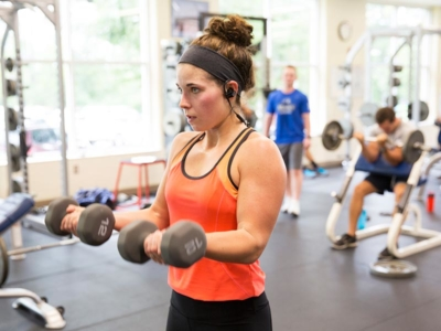 A female student works out in the weight room